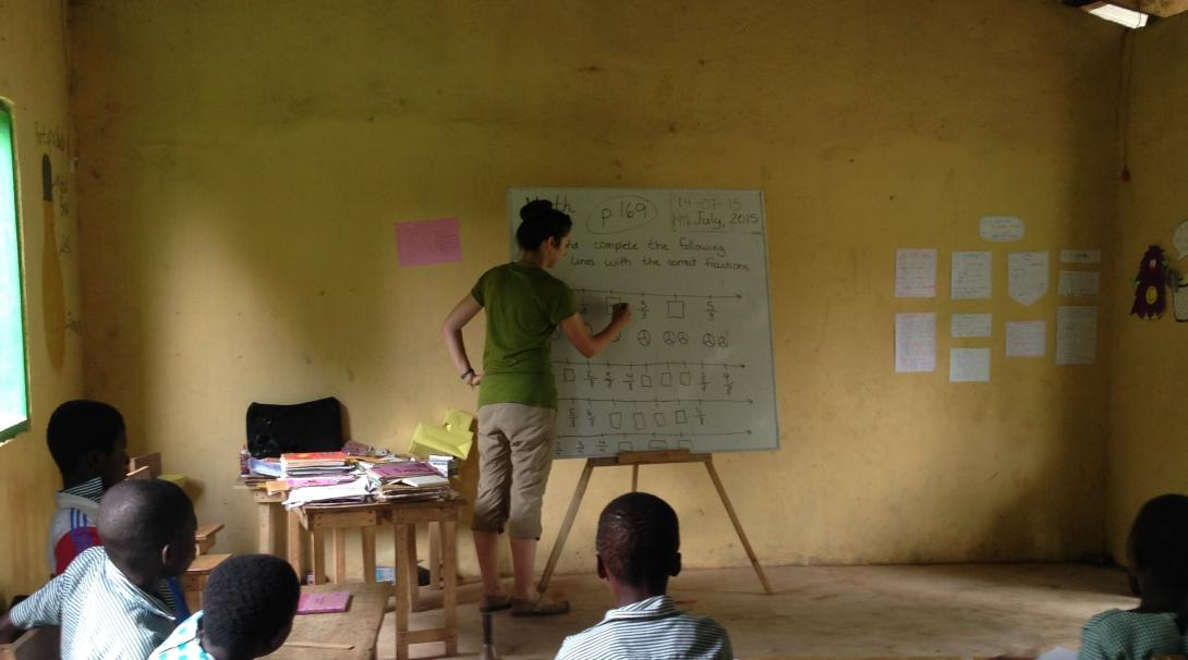 A volunteer doing a teaching English program with Projects Abroad prepares a lesson to local students in Ghana.